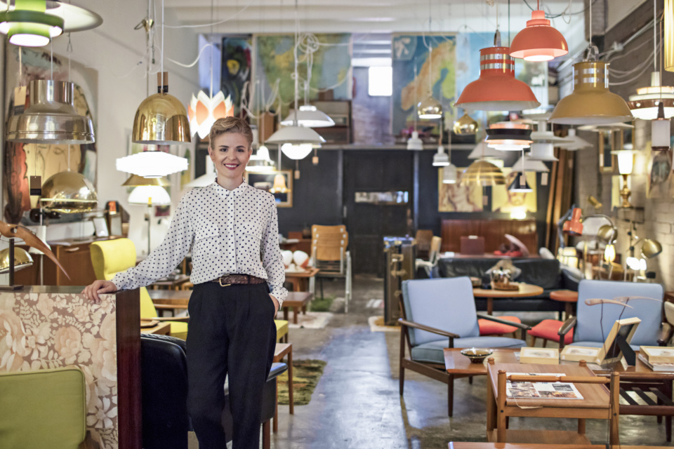 Portrait of a female business owner standing in her furniture store 864246514 2125x1416