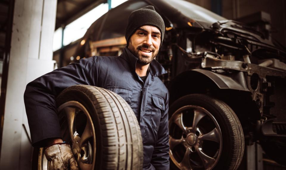 Mechanic man repair a tire 1126886132 2245x1341
